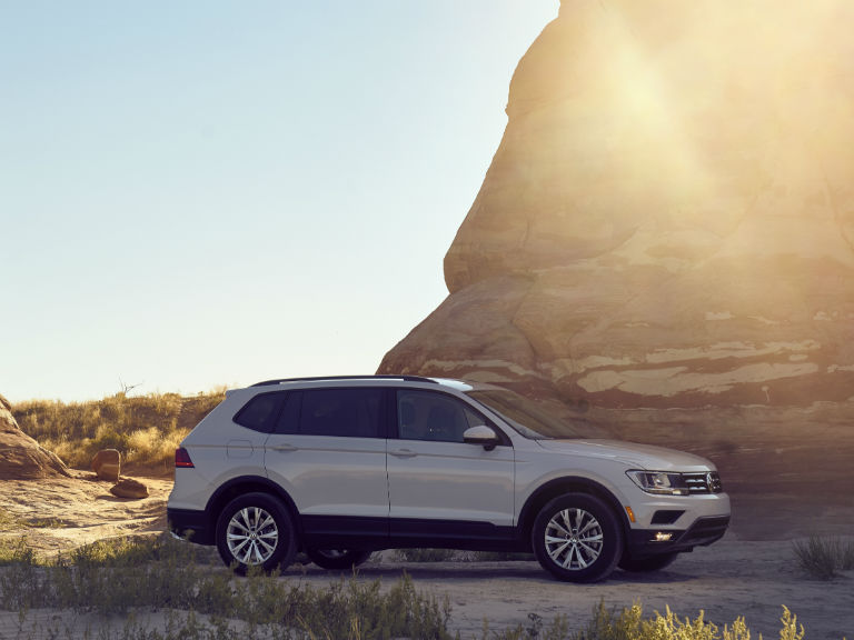 side view of a white 2019 VW Tiguan