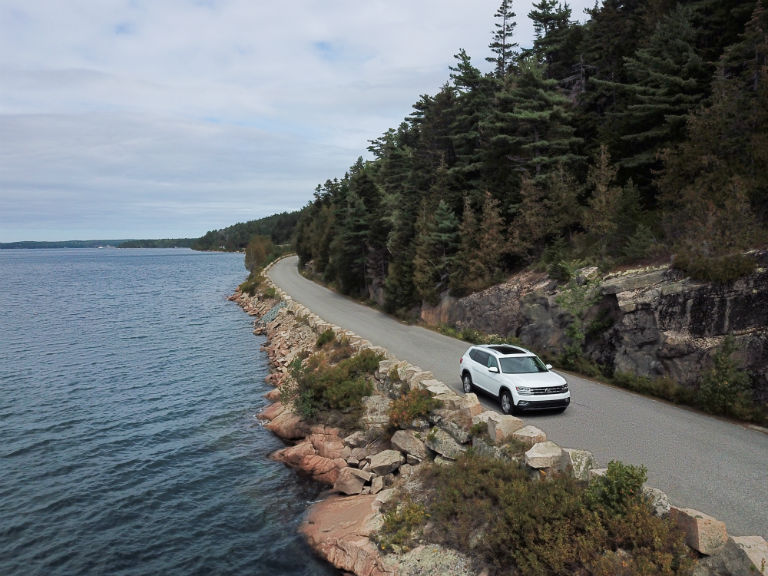 high angle view of a white 2019 VW Atlas driving along the coast