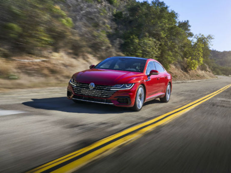 side view of a red 2019 VW Arteon