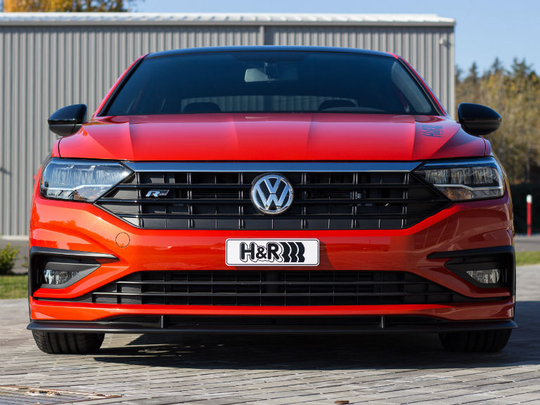 front of a red 2019 VW Jetta