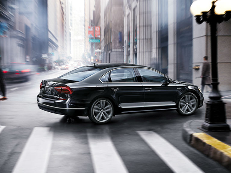 side view of a black 2019 VW Passat