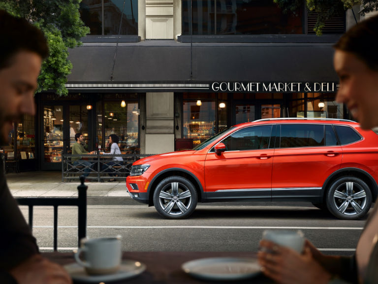 side view of a red 2019 VW Tiguan
