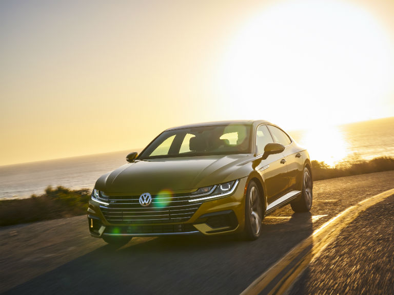 front view of a yellow 2019 VW Arteon