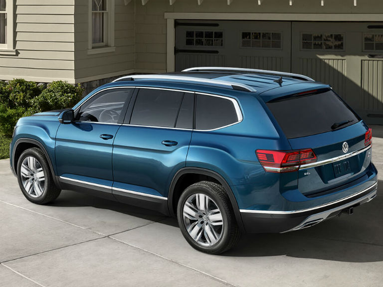side view of a blue 2020 VW Atlas