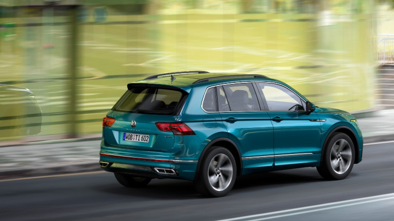 side view of a green 2022 VW Tiguan