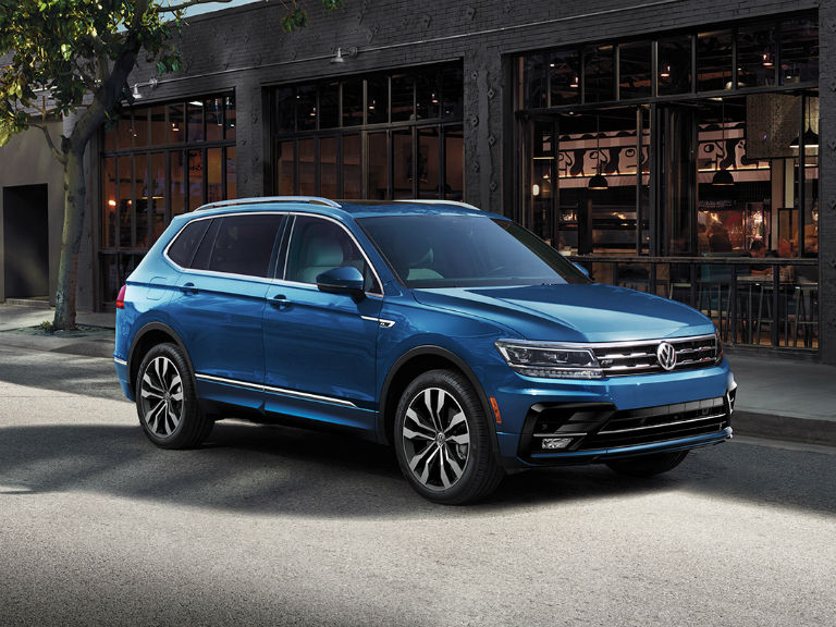 side view of a blue 2021 VW Tiguan