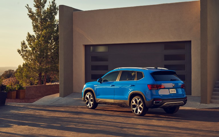 side view of a blue 2022 VW Taos