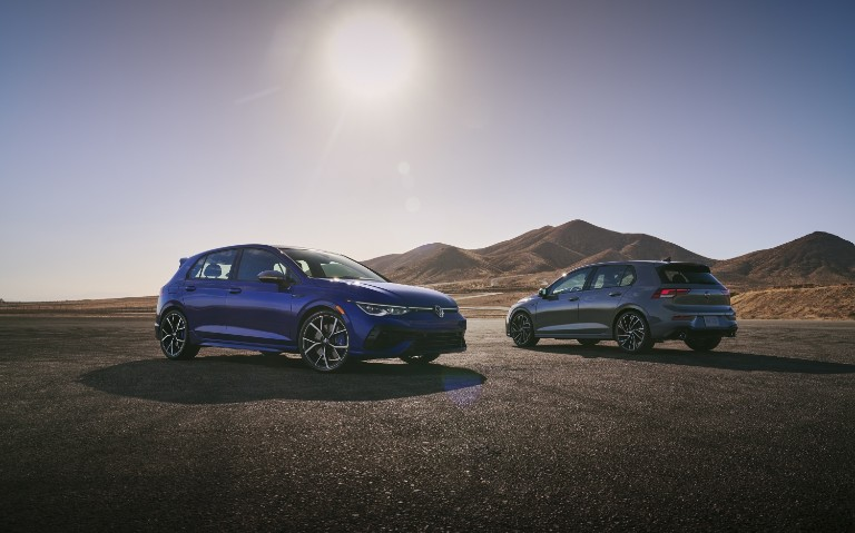 a 2022 VW Golf GTI and a 2022 VW Golf R next to each other