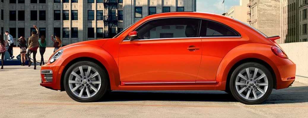 Profile view of orange 2019 Volkswagen Beetle