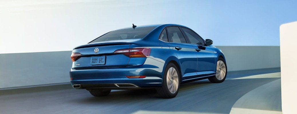 Rear shot of blue 2019 Volkswagen Jetta driving on ramp