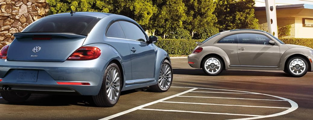 Two 2019 Volkswagen Beetle models in parking lot