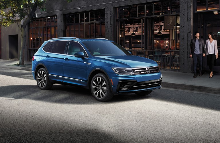 Blue 2020 VW Tiguan parked on city curb