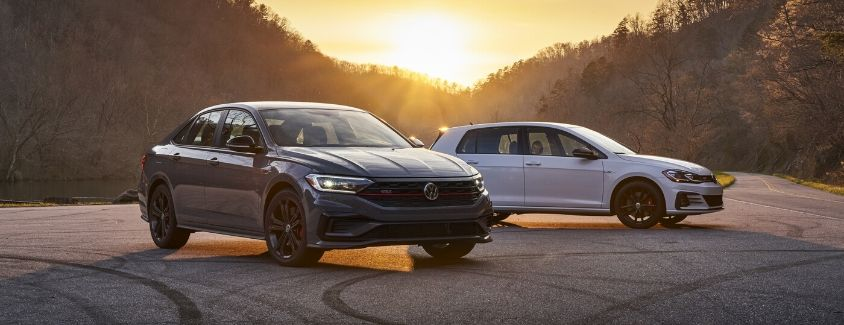 Exterior view of a 2020 Volkswagen Golf GTI and a Jetta GLI