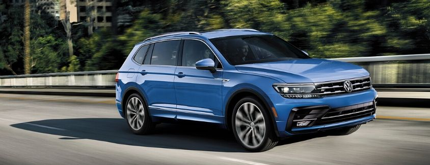 Exterior view of the front of a blue 2020 Volkswagen Tiguan