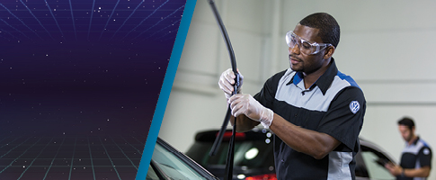 Wiper Blade Installation special with a service technician installing a wiper blade