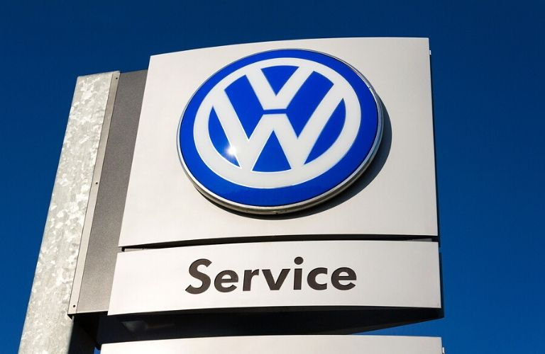 Image of a Volkswagen Service sign at a dealership