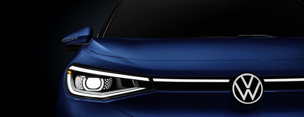 Closeup view of the front grille and headlight of a blue 2021 Volkswagen ID.4