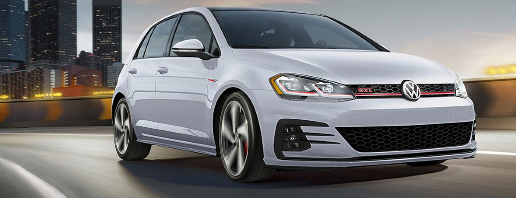 White 2020 Volkswagen Golf GTI driving down road