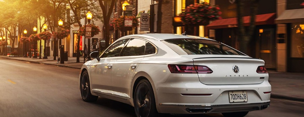 2020 Volkswagen Arteon driving on a city road toward the sunset