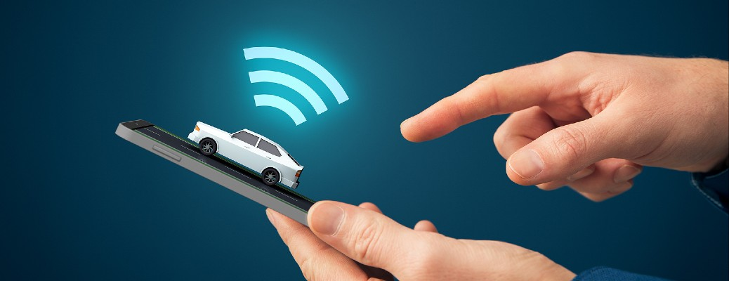 A person pushing a button on their smartphone with an image of a small car is hovering over it with three bright, curved lines on top