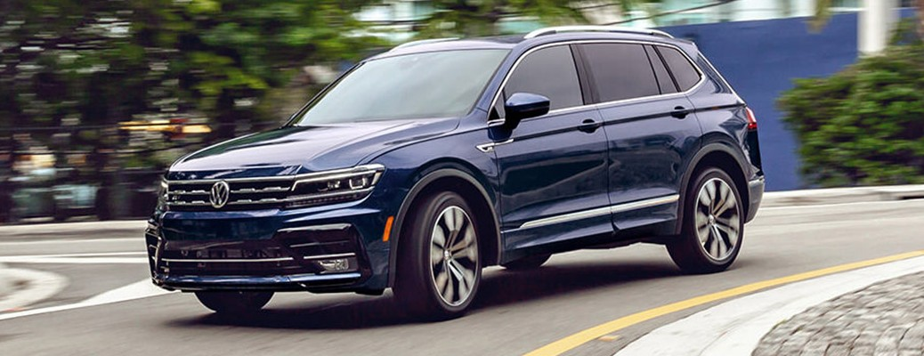 A 2021 Volkswagen Tiguan driving on a curved roadway