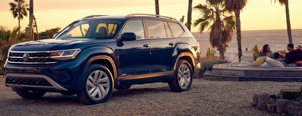 A 2021 Volkswagen Atlas parked on a beach near a body of water