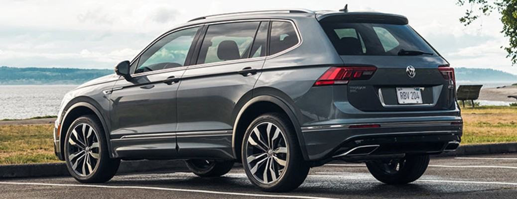 A 2021 Volkswagen Tiguan parked outside near a body of water