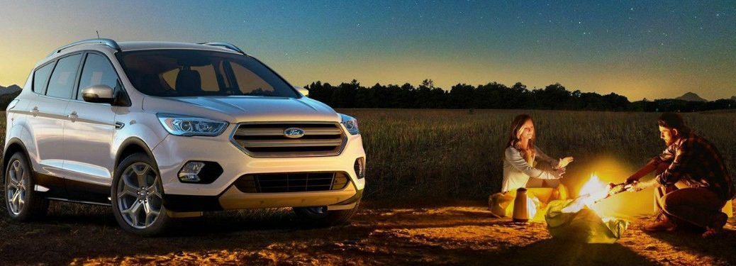 2019 Ford Escape with people camping near it