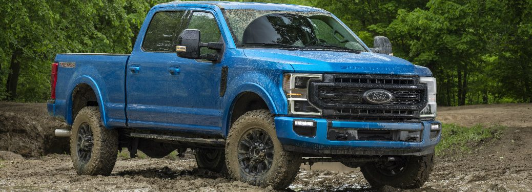 Blue 2020 Ford F-Series Super Duty Tremor Off-Road Package parked on muddy terrain