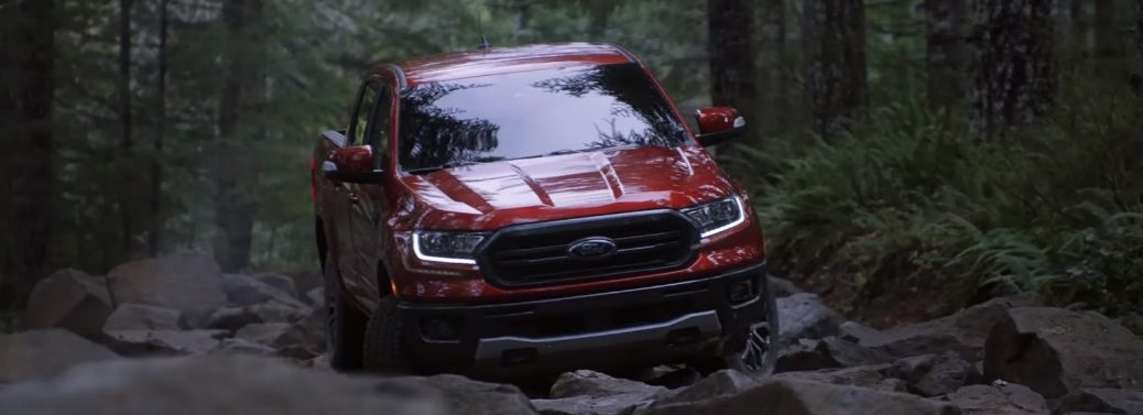 Red 2019 Ford Ranger driving on rocky terrain