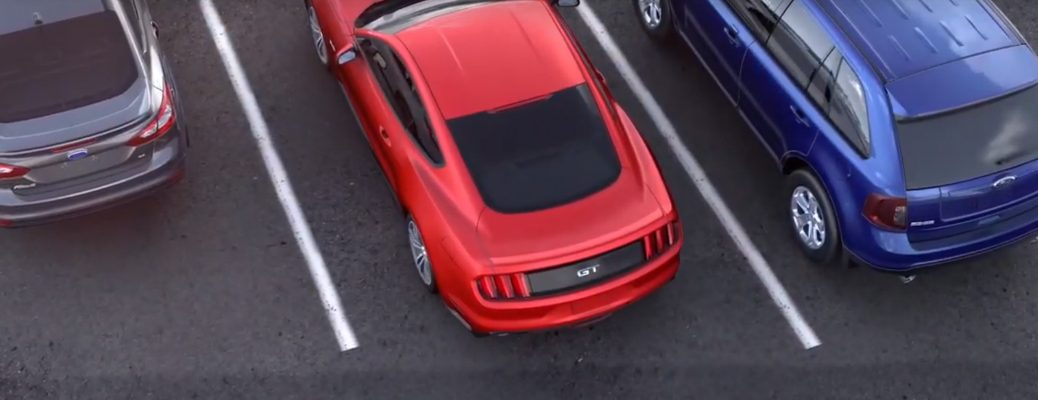 Red Ford Mustang pulling out of a parking spot