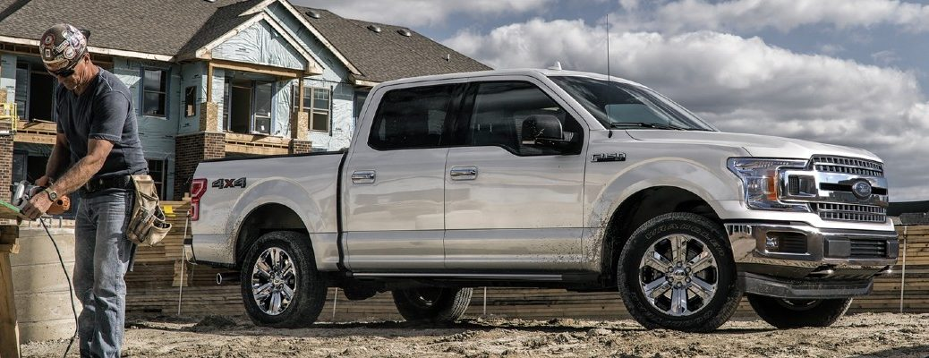 2020 Ford F-150 silver paint exterior shot outside a house construction site facing right