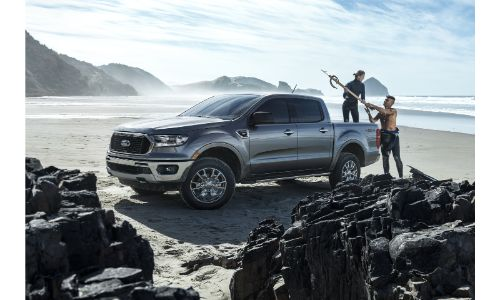 2020 Ford Ranger parked on beach gray paint facing left rocks in foreground