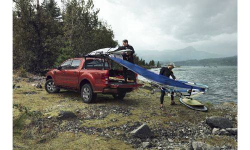 2020 Ford Ranger Red paint parked on grassy slope with slide on bed