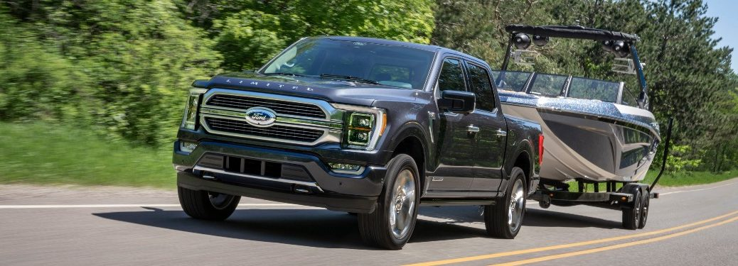 2021 Ford F-150 tows a boat up a highway
