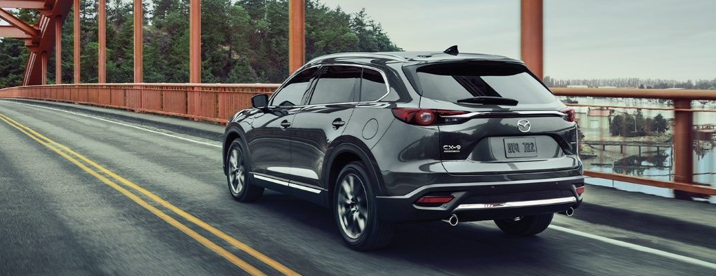 2020 Mazda CX-9 exterior rear shot with grey paint color crossing a bridge