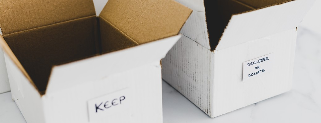 Two cardboard boxes for keeping and decluttering