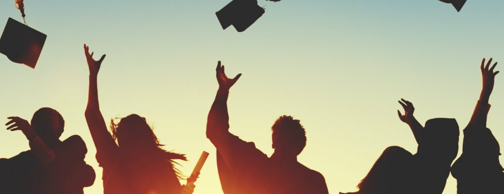 College graduates tossing their caps in the air