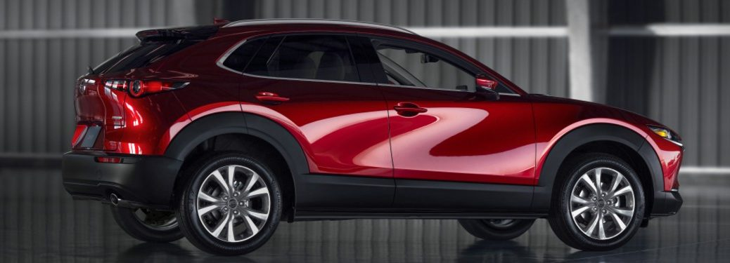 Rear passenger angle of a red 2020 Mazda CX-30