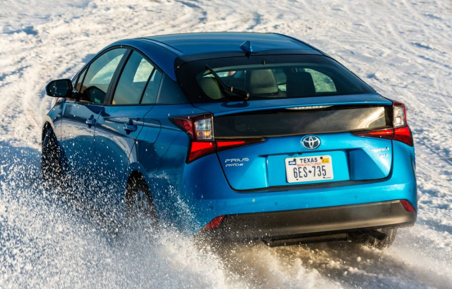 2019 Toyota Prius XLE AWD-e Exterior Driver Side Rear Angle in Snow