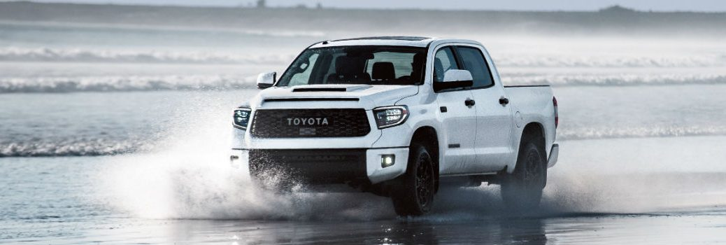 2019 Toyota Tundra TRD Pro CrewMax Super White Exterior Driver Side Front Profile in Water