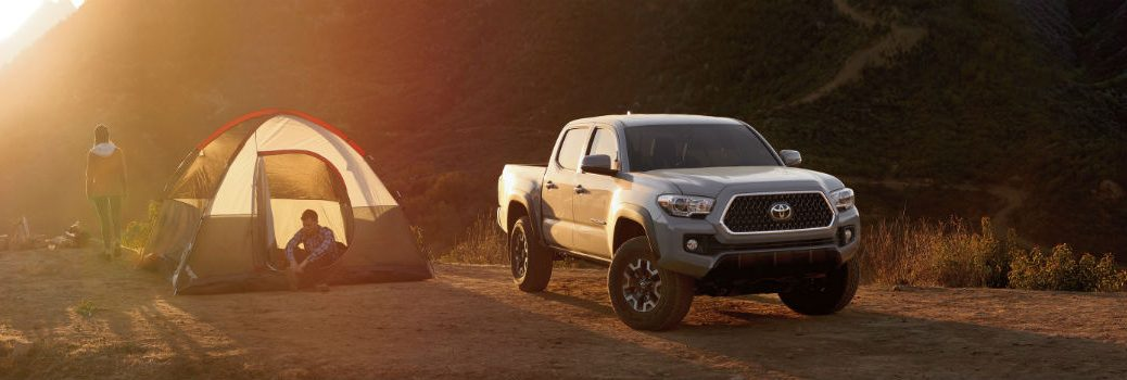 2019 Toyota Tacoma Exterior Passenger Side Front Angle Next to Tent