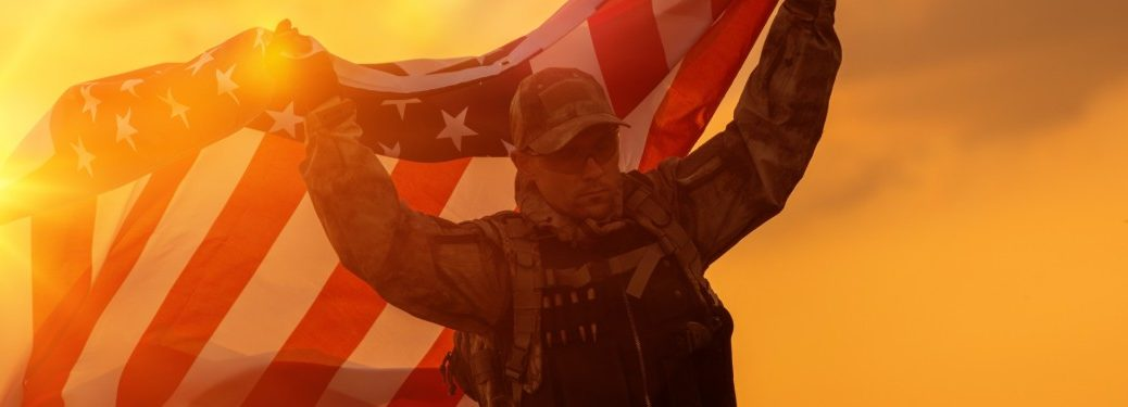 Soldier in Uniform Carrying the American Flag above his head