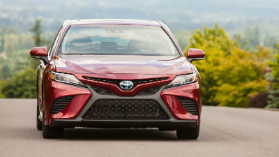 2020 Camry hybrid driving up a hill
