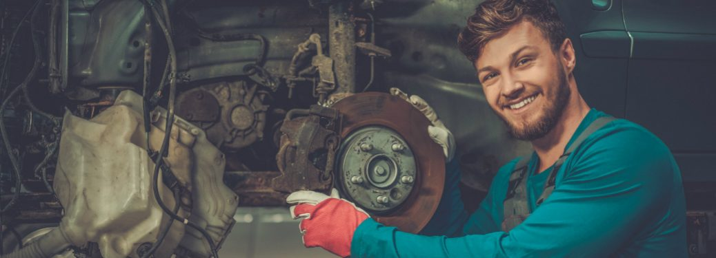 smiling person working on rotors