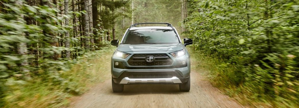 2020 RAV4 driving through wooded area