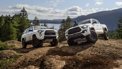 2020 Tacoma TRD and 2020 4Runner TRD parked on rocky outcrop