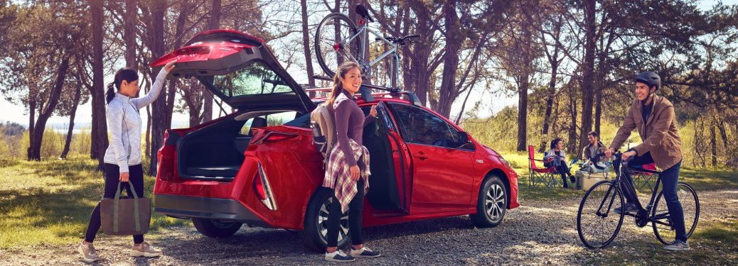 2020 Prius Prime on a trail carrying outdoor sporting goods