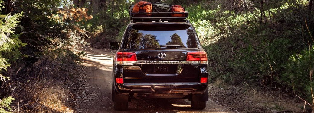 2020 LAnd Cruiser driving down a forested trail