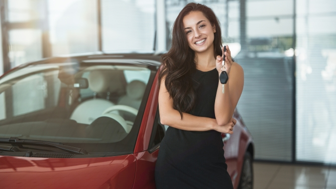 Happy person holding keys to new vehicle